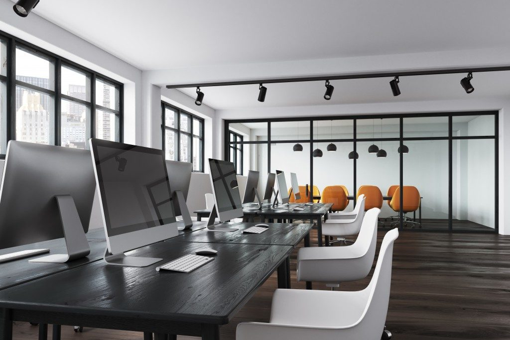 Office with black tables and white chairs
