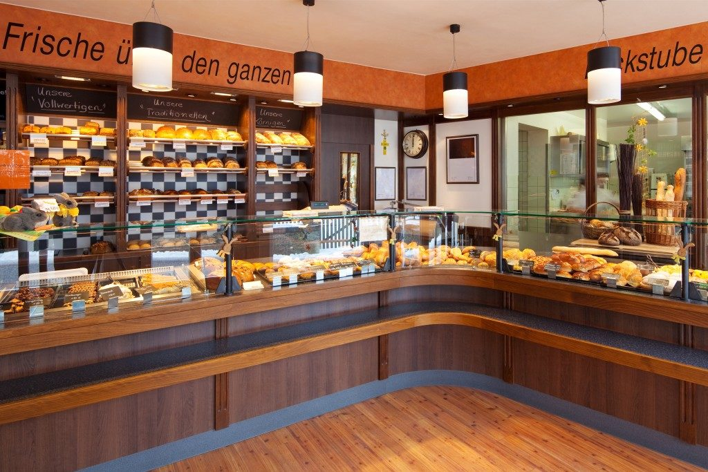 Modern bakery interior with glass display counters