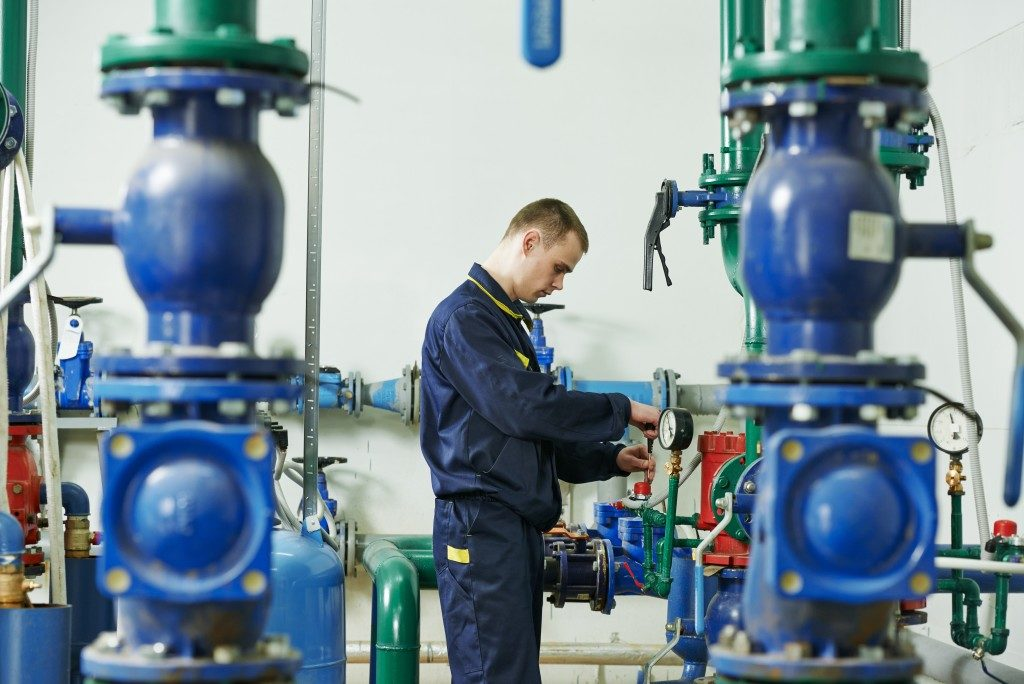 man checking water centrifugal pump
