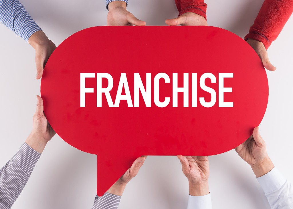 Group of People Holding Franchise bubble word