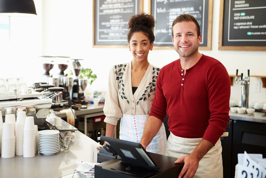 Man and woman managing a coffee shop