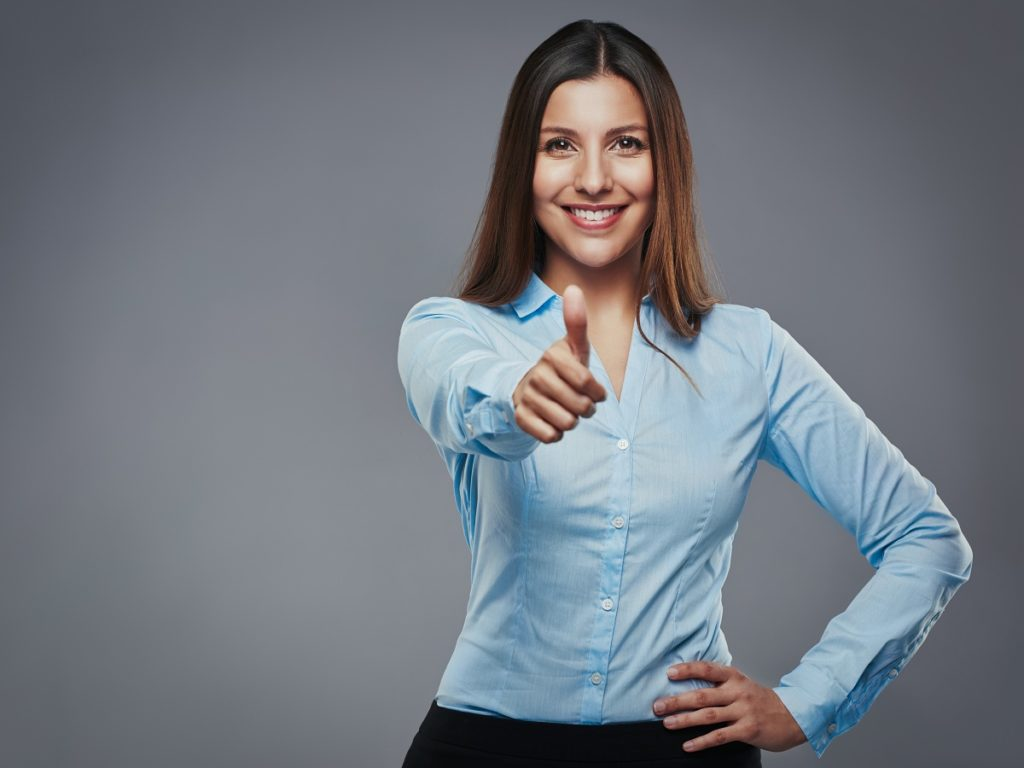 Female entrepreneur thumbs up