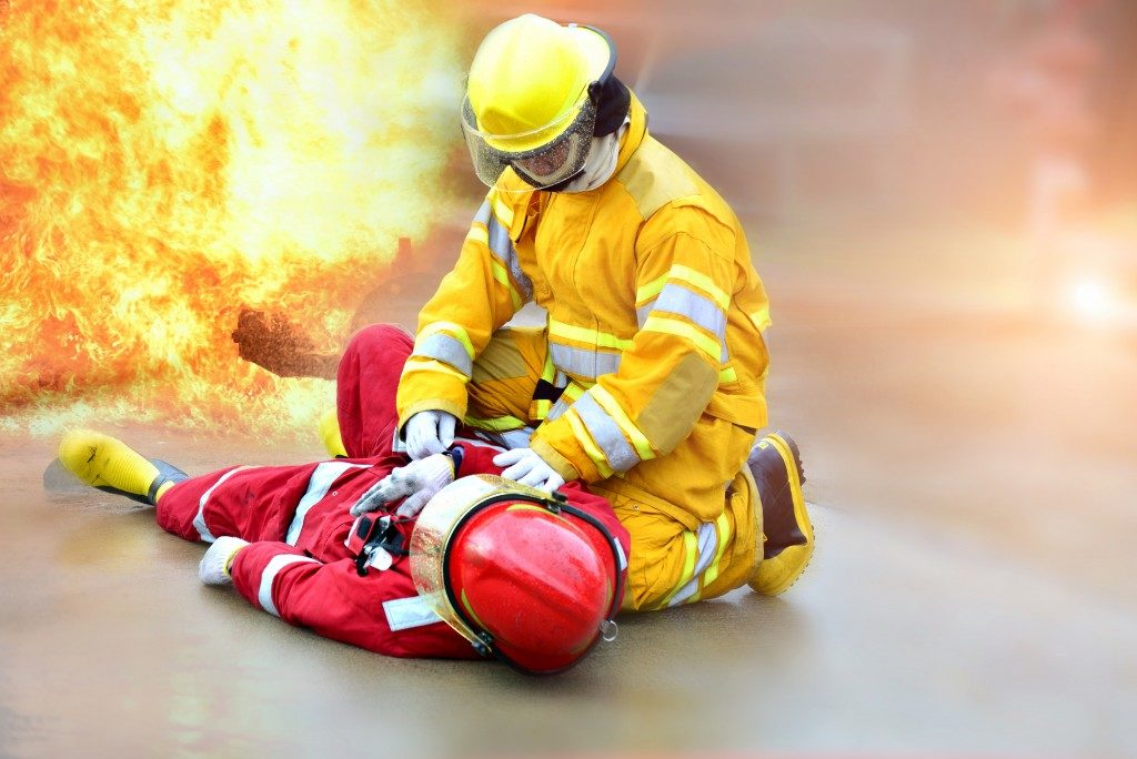 firefighter doing cpr