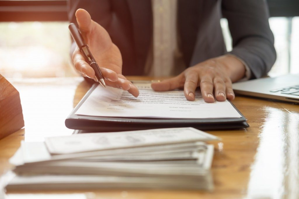 Insurance agent holding a contract