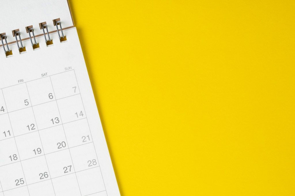 calendar in top of a yellow table