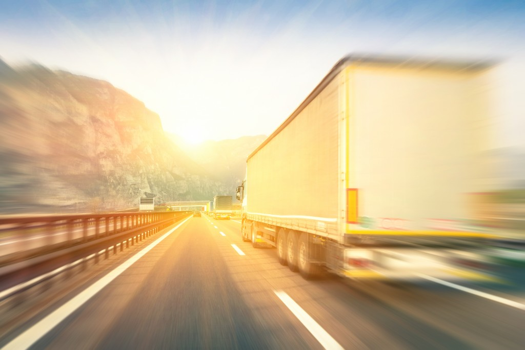 truck driving fast along the highway