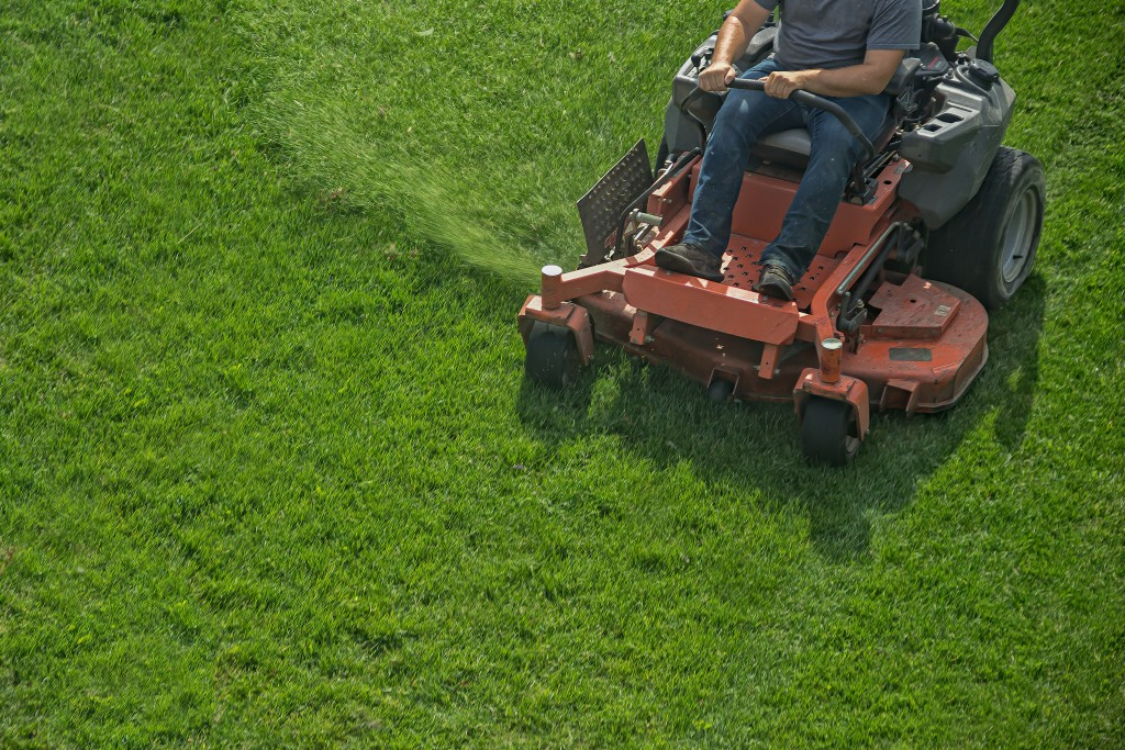 man using a lawn mower