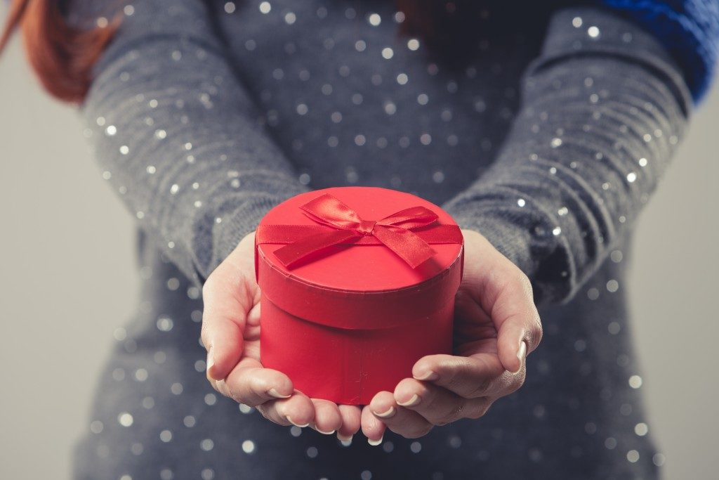 woman holding a red gift box