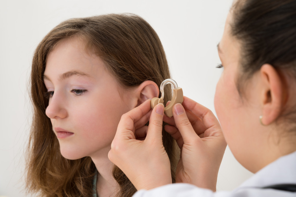 doctor checking patient's ear