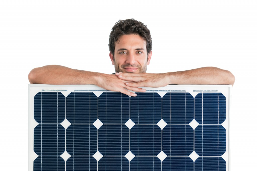 man holding a solar panel