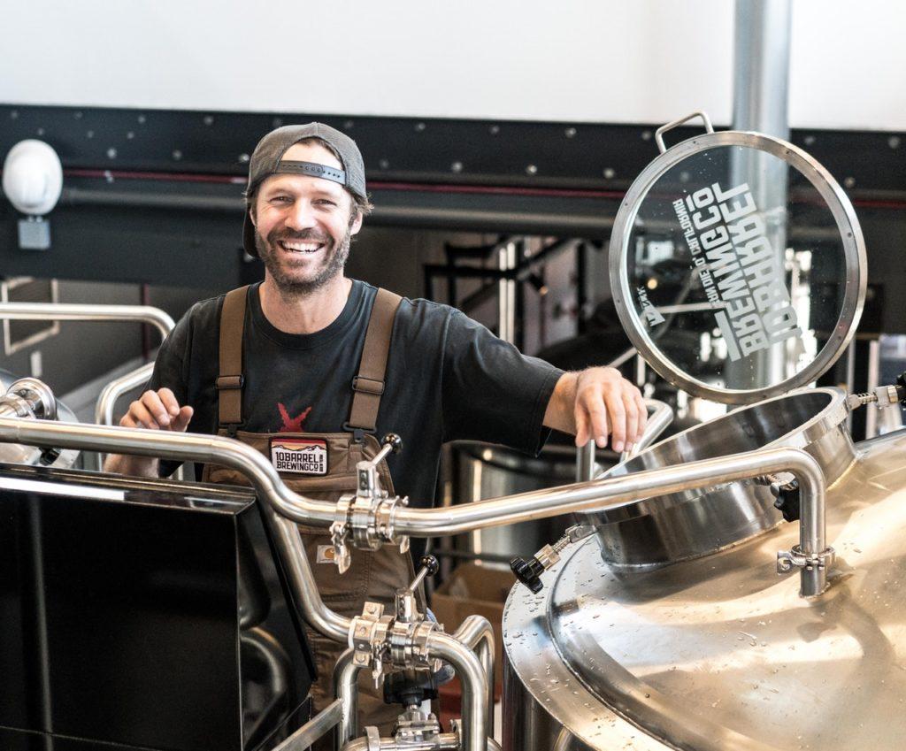 man working as a brewer