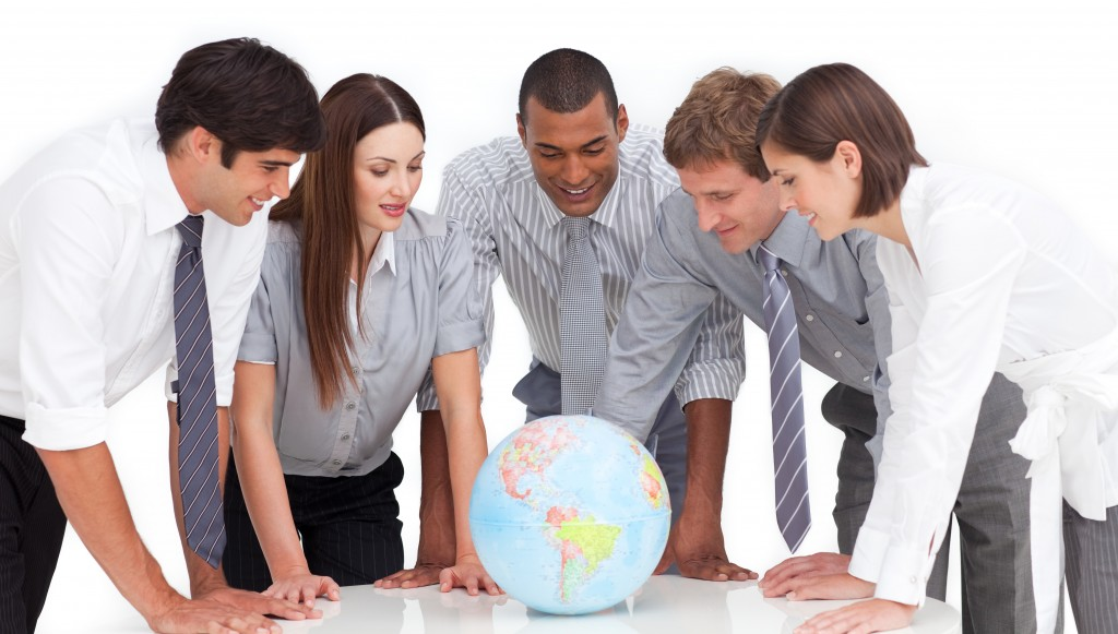 people looking at a globe