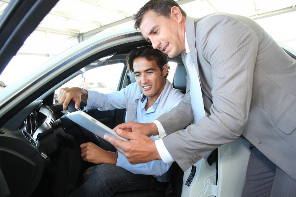 car rental employee and customer