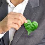 holding a heart shaped leaf
